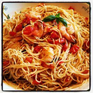 Shrimp with a Fresh Plum Tomato Basil Sauce over Angel Hair