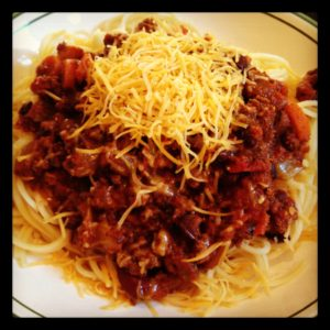Total comfort food. Hearty, flavorful, delicious Warm The Soul Chili! I love serving it over spaghetti and topped with a mound of shredded cheddar!
