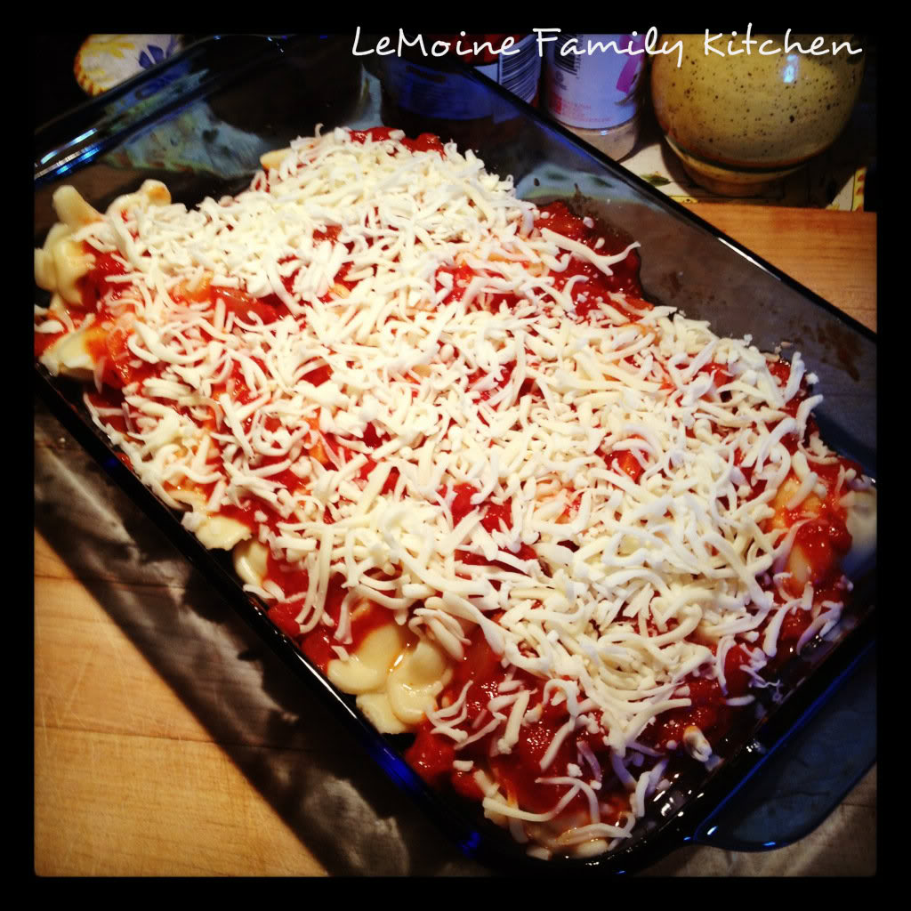 Some days you just need an uncomplicated quick dinner and this one is just that! Easy Baked Ravioli is like a lasagna made super simple! Tasty, fun and throw together quickly any night of the week!