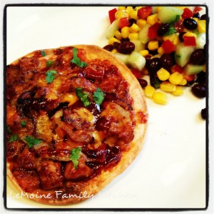 BBQ Pork Tortilla Pizza makes for a great, quick and easy weeknight dinner! Crisp tortilla crust covered with pork, bbq sauce and cheese!