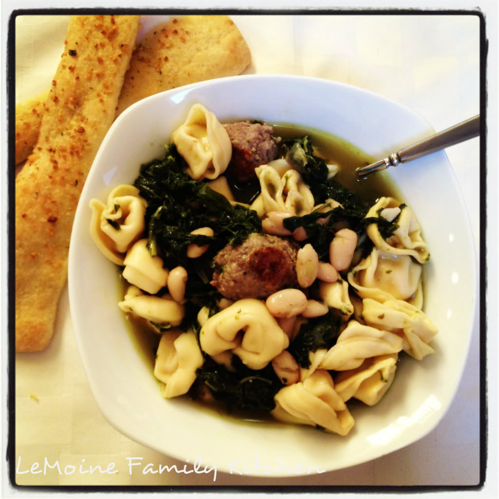 Tortellini with Kale, Cannellini Beans and Sausage in Broth. I love these types of meals. They are rustic, flavorful, easy to make and comforting! Great warm up dinner. I served this with warm cheesy garlic bread sticks.
