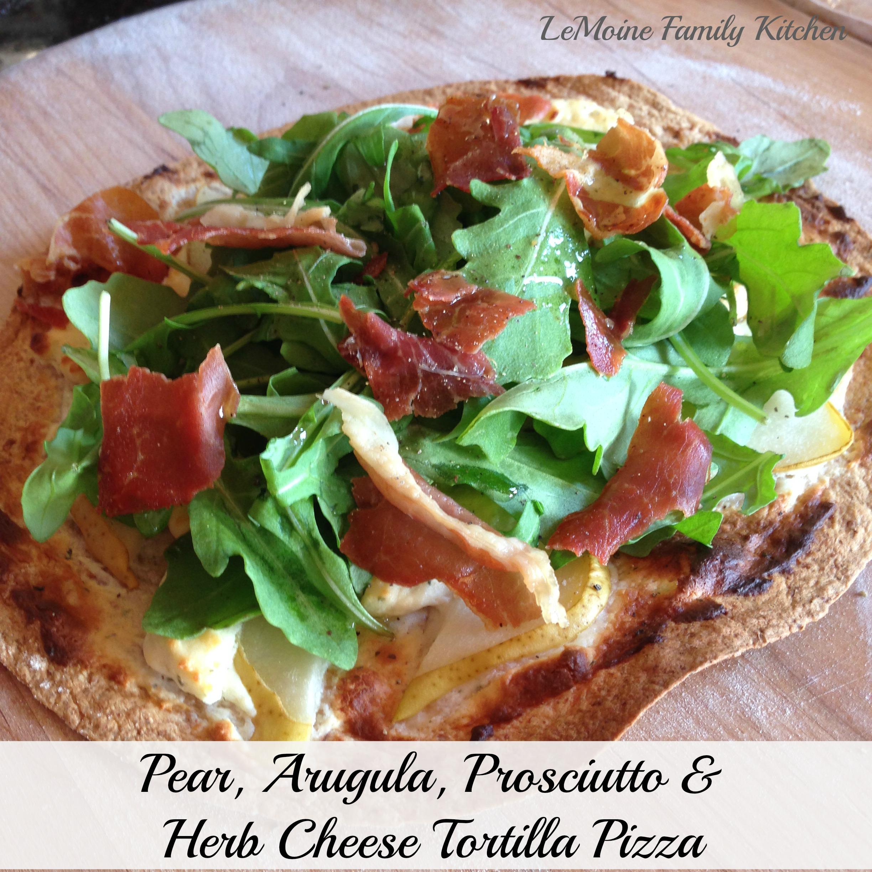 pear, arugula, prosciutto and herb cheese pizza