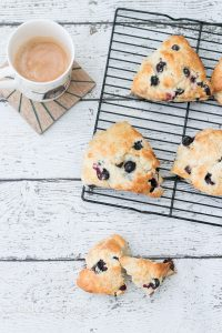 I am rather obsessed with baking up scones especially these Blueberry Scones! They are really simple to make and they come out absolutely perfect every single time!! Its a great base recipe that you can really create endless varieties with!