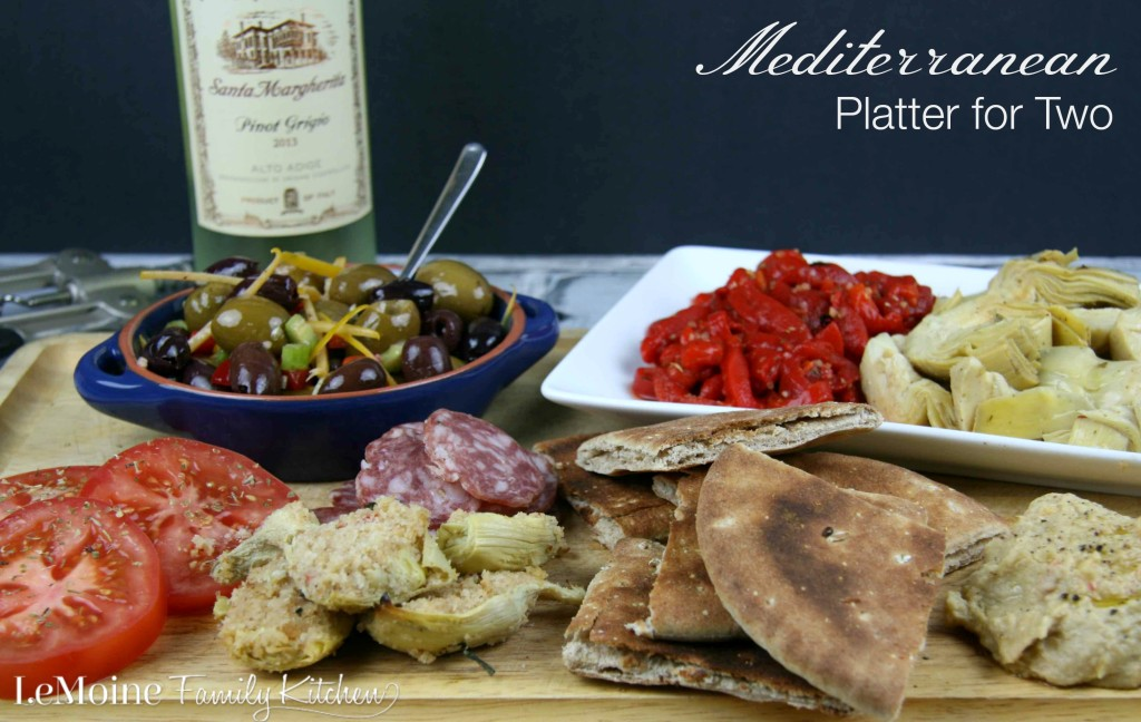 Mediterranean Platter for Two | LeMoine Family Kitchen. Grab a bottle of wine and enjoy an array of olives, hummus, artichoke hearts, soppresata, roasted peppers and pita.