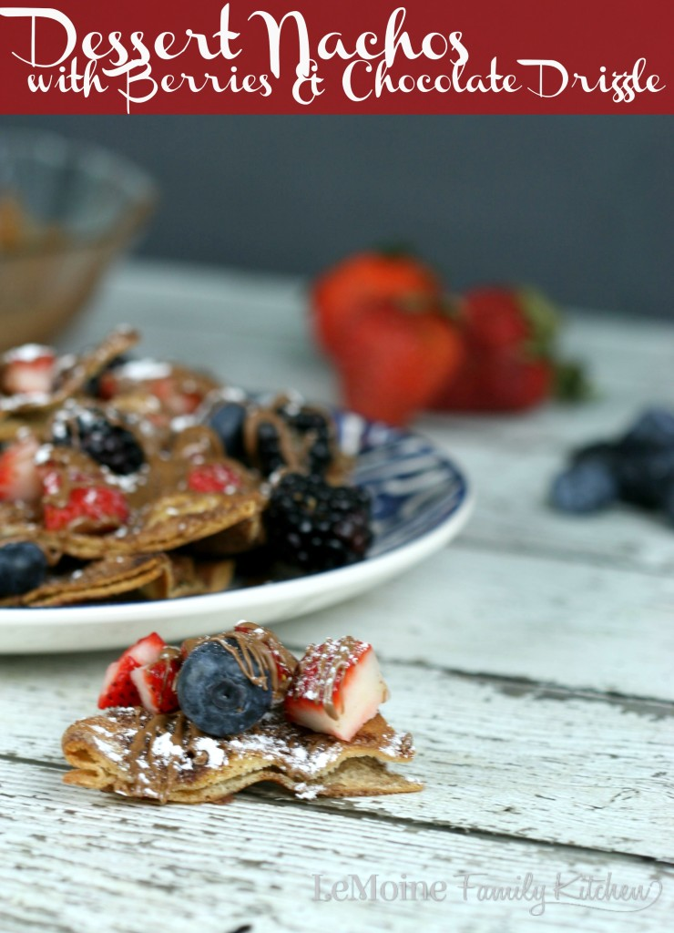 Dessert Nachos  with Berries & Chocolate Drizzle | LeMoine Family Kitchen. Cinnamon sugar pita chips topped with fresh berries, a drizzle of melted chocolate and some powdered sugar. Easy and delicious dessert!