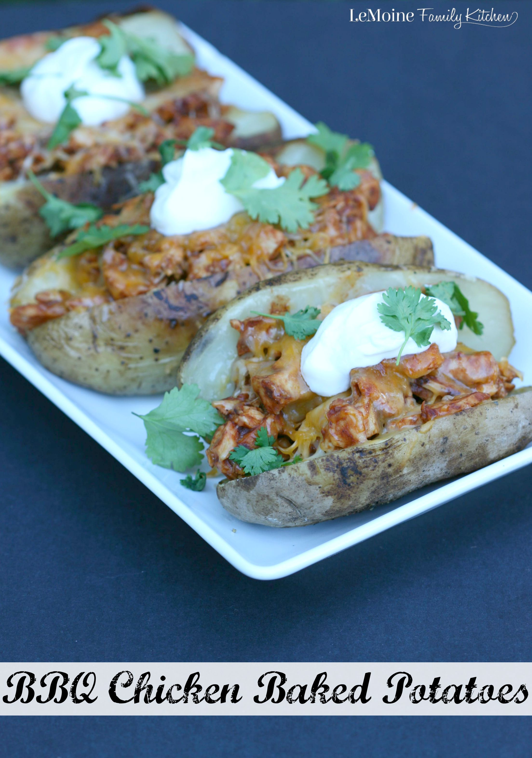 BBQ Chicken Baked Potatoes | LeMoine Family Kitchen. Easy weeknight meal. Diced up rotisserie chicken tossed with bbq sauce, placed inside a baked potato, topped with cheddar, sour cream and fresh cilantro. Delicious!