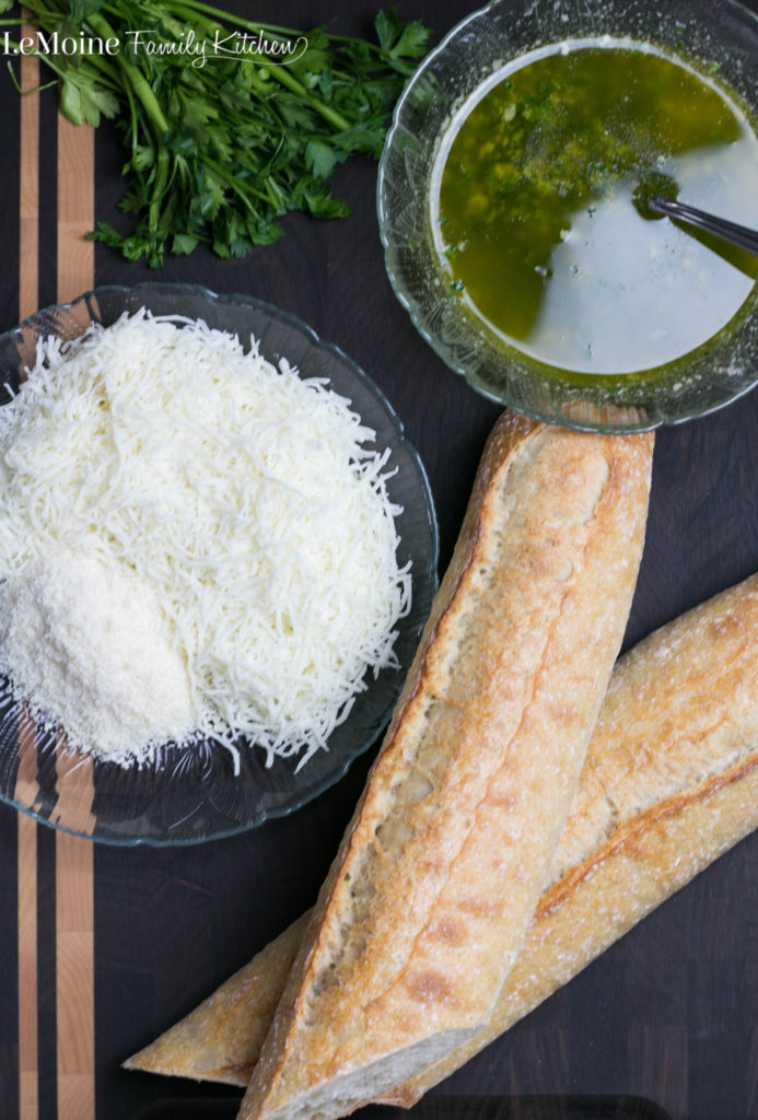 Cheesy Garlic Bread | LeMoine Family Kitchen . This is the ULTIMATE garlic bread!! Butter, EVOO, garlic, parsley and lots of cheese!!! Just perfect!