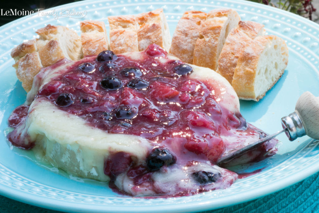 Baked Brie with Fresh Peach and Blueberry Compote is an easy and delicious appetizer! Buttery, creamy, warm brie topped with a sweet fresh compote. #FreakyFriday