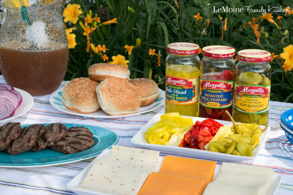 Build Your Own Burger Bar this Summer. Create a simple and delicious spread with all sorts of toppings including #Mezzetta Peppers! #ad #BoldBrightSummer
