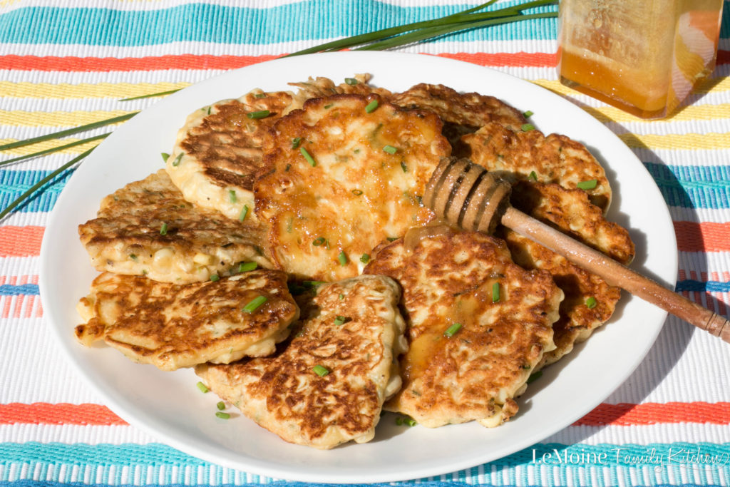 Corn & Chive Fritters. Summer corn is so so good and this is one of my favorite easy recipes to make with it. Lots of chives and drizzled with local honey, these fritters are heaven!