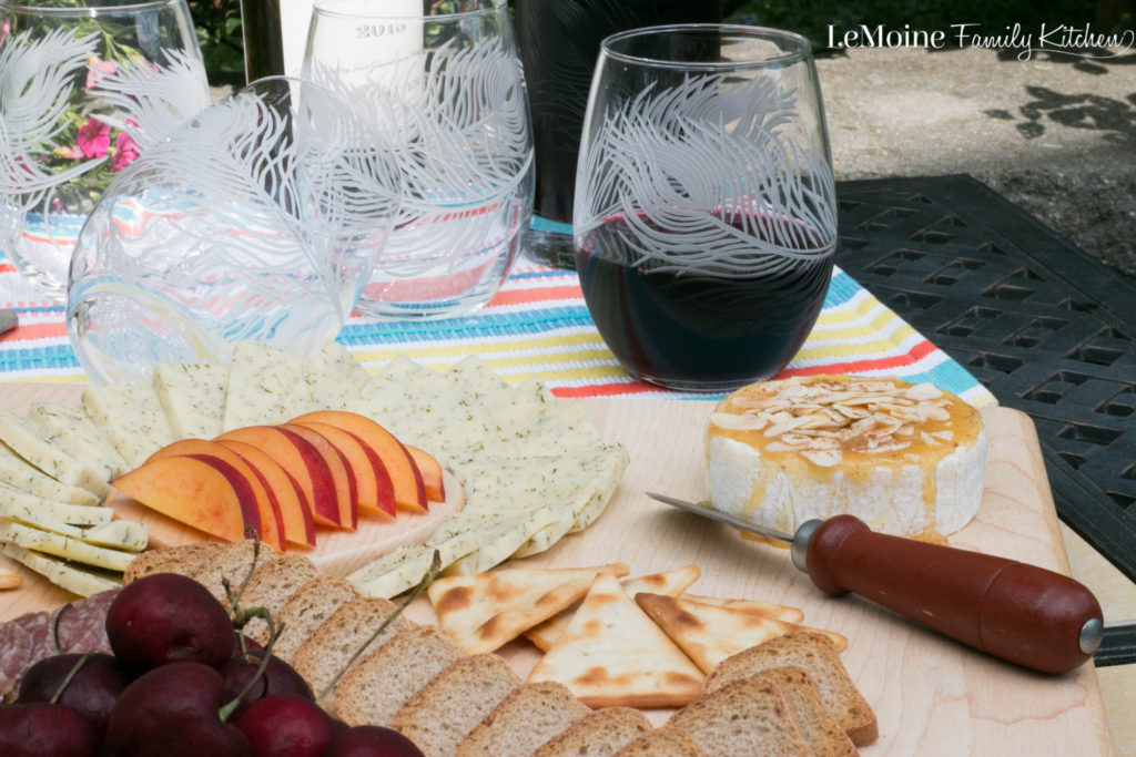 Summer Wine & Cheese Platter. My favorite kind of at home date night. Simple, elegant and so delicious!!! Gorgeous serving board, wine glasses and decanter from Uncommon Goods. #ad