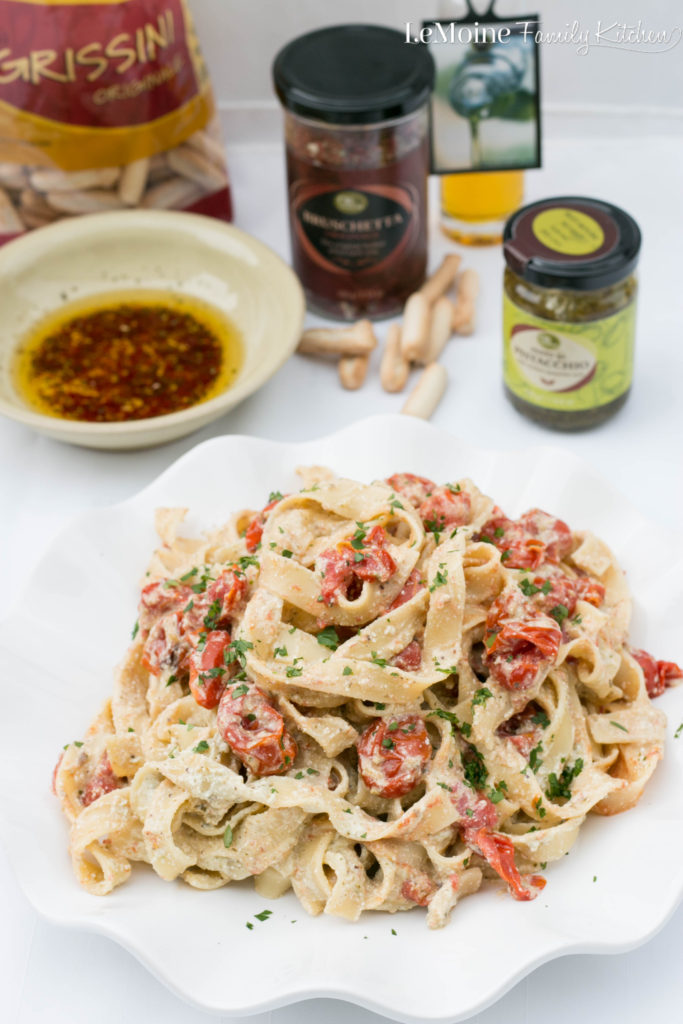 Tagliatelle with Roasted Tomatoes & Pesto Ricotta. A quick and flavorful dinner. Grape tomatoes roasted until bursting with caramelization. A simple pesto ricotta makes a creamy and luscious sauce. #oilvinegar #ad