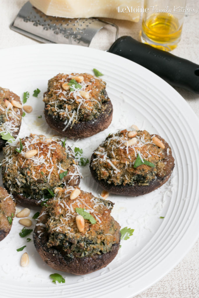 Creamed Kale Stuffed Mushrooms. Absolutely delicious and easy to make, these mushrooms are an incredible side dish worthy of a spot on any table for the holidays. We love them on Thanksgiving and Christmas!
