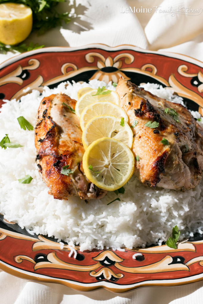 Roasted Lemon Oregano Chicken. A simple and delicious weeknight meal. Bone in skin on chicken breasts are marinated in olive oil, lemon zest, lemon juice, oregano, salt and pepper then roasted until golden and perfectly juicy.