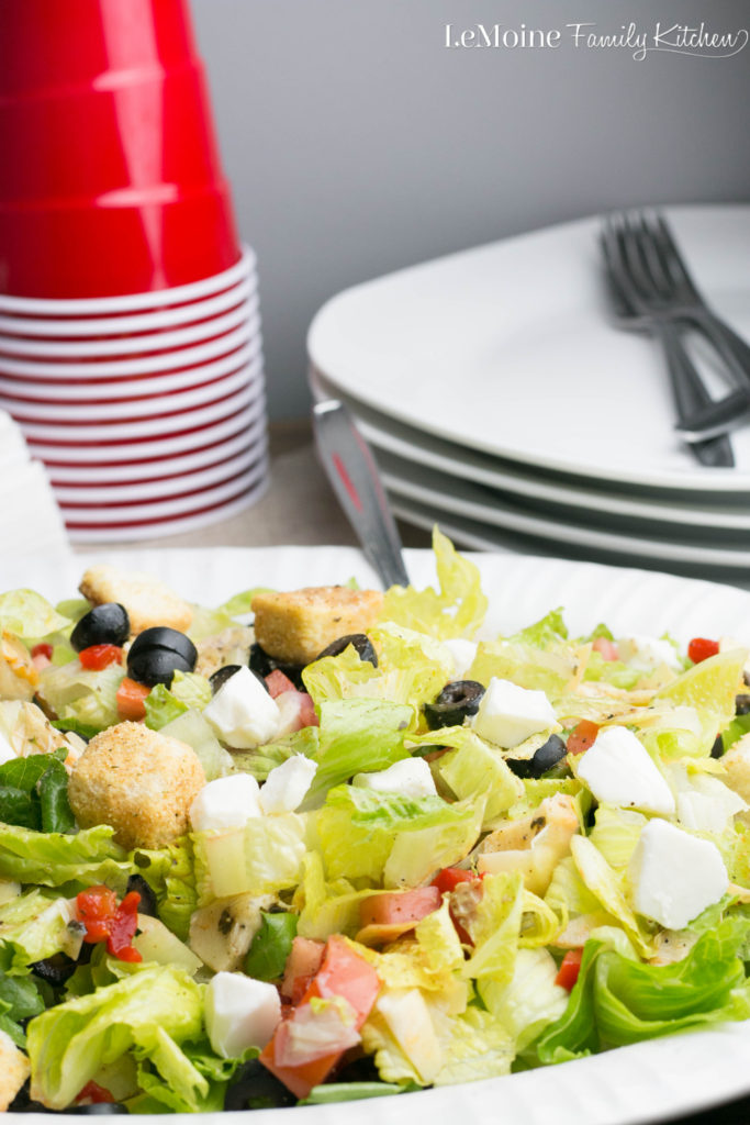 This Chopped Antipasto Salad is so simple to throw together and just the perfect pairing for Freschetta Naturally Rising Pizza. Chopped romaine lettuce, pearl mozzarella balls, artichoke hearts, roasted peppers, tomatoes, black olives, croutons and Italian dressing. What a great dinner any night of the week!