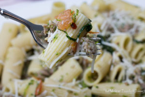 Rigatoni with Sausage & Broccoli Rabe. A simple, flavorful, Italian pasta dish. The perfectly al dente pasta with the sweet Italian sausage, hearty greens and kick of spice from some crushed red pepper flakes. This one comes together quickly making for a perfect weeknight dinner.