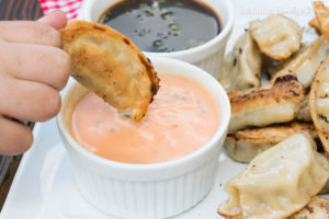 I'm making your summer entertaining really easy and really delicious! These Potstickers with a Sweet Chili Dipping Sauce are absolutely delicious and will fly off the plate at your next get together!