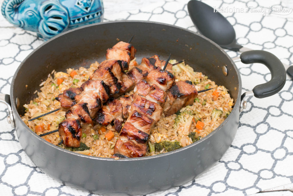 Easy Grilled Asian Pork Kebab. Delicious easy marinaded pork grilled to perfection and served over homemade fried rice. A great summer dinner!