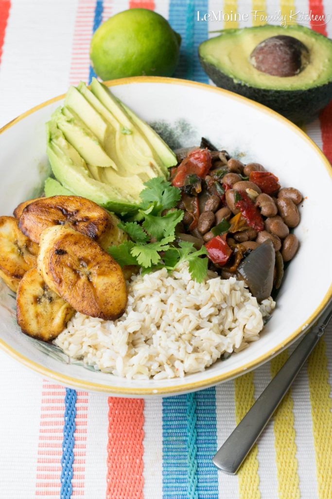 This Cuban Rice & Beans Bowl is so easy, healthy and absolutely delicious!!! Perfect meal for any night of the week. Sweet plantains, brown rice, sliced avocado and perfectly seasoned pinto beans.