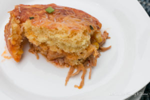 Pork Enchilada Cornbread Bake. Slow cooked pork topped with a boxed cornbread mix and finished with cheese and scallions. Perfect weeknight meal!