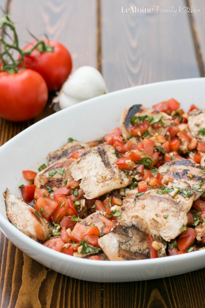 Bruschetta Grilled Chicken. A flavor packed summer meal. Simple to make, healthy and bright fresh flavor.