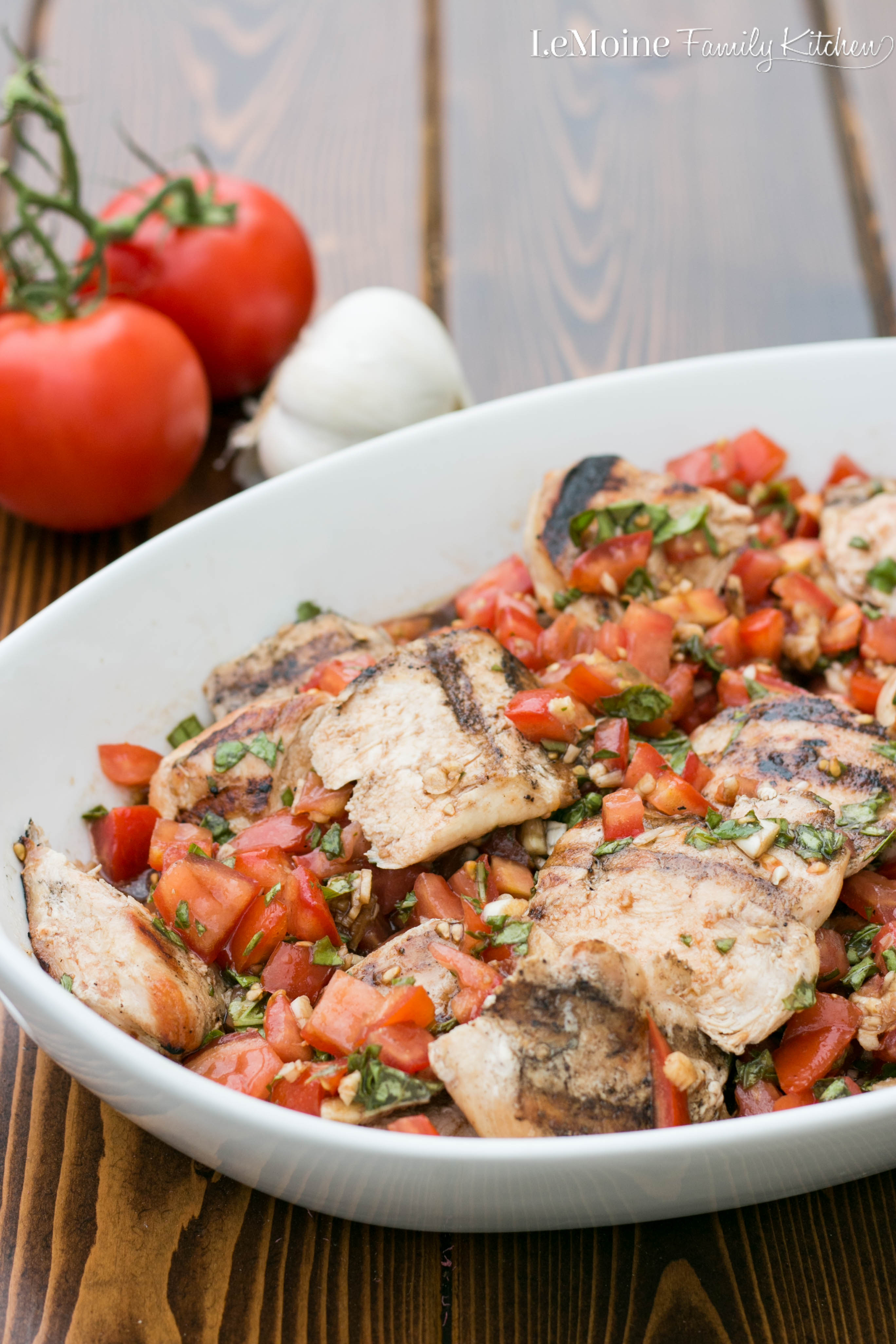Bruschetta Grilled Chicken. A perfect  summer meal. Simple to make, healthy and bright fresh flavor. Grilled chicken topped with juicy sweet tomatoes, lots of fresh basil, some garlic, olive oil and a drizzle of balsamic vinegar.