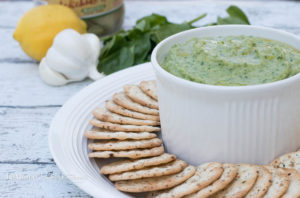 5 minutes is all you need to make this bright, fresh, delicious Spinach Artichoke White Bean Dip!  Its actually super healthy too which is a great little bonus. Cannellini beans, artichoke hearts, spinach, garlic, lemon zest and olive oil are blended together until smooth to get this fantastic quick & easy dip.