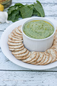 5 minutes is all you need to make this bright, fresh, deliciousSpinach Artichoke White Bean Dip! Its actually super healthy too which is a great little bonus. Cannellini beans, artichoke hearts, spinach, garlic, lemon zest and olive oil are blended together until smooth to get this fantastic quick & easy dip.