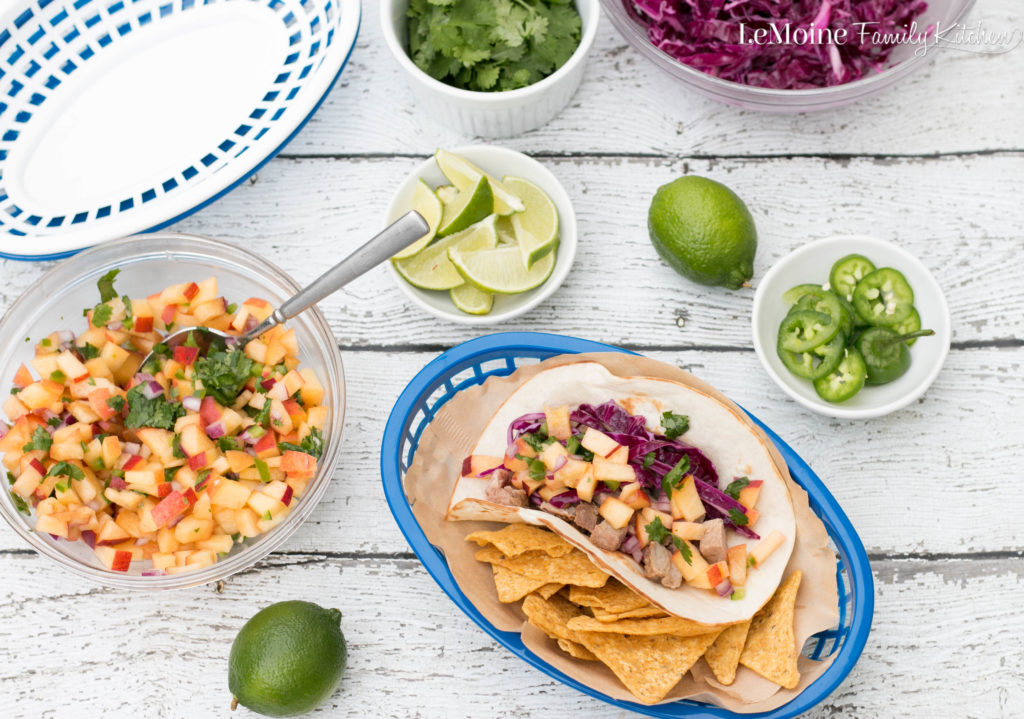 We really love taco nights in our house and let me tell you, these Pork Tacos with Sweet & Spicy Peach Salsa were a huge hit! This meal is not only delicious and colorful but it is on the table in 30 minutes! You are going to love this recipe! #ad #realflavorrealfast