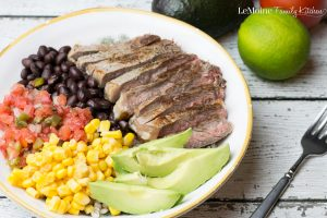 You eat with your eyes first right? So when you see an awesomely colorful bowl like this Tex Mex Steak Bowl don't you just want to dive right in? I sure do! This meal is incredibly easy and so tasty! Tender, juicy steak, corn, fresh salsa and black beans over barley and finished with fresh lime juice. Healthy made delicious!