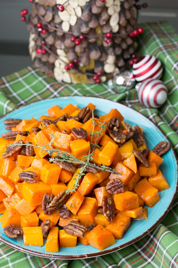 When it comes to holiday entertaining we are always a big group so I like to keep things really simple. This Roasted Butternut Squash with Spiced Pecans is so flavorful and easy to throw together. How gorgeous are the colors too?!
