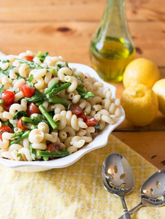 The weather is finally warming up and I am super excited for outdoor entertaining! ThisLemon Basil Pasta Salad with Asparagus & Tomato is bursting with flavor and the perfect addition to any summer get together!