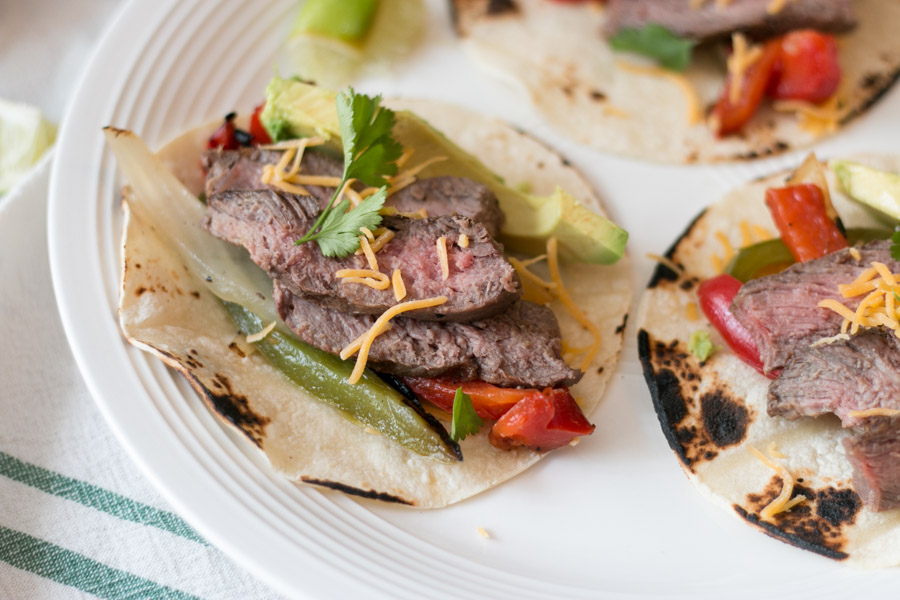 Clearly I'm on a bit of a grilling kick lately. While this week has been a very rainy one, I was able to get these gorgeous N.Y Strip Steaks from Claytons Organic Beef on the grill before the storms. These Grilled Steak Fajitas are such an easy and flavorful meal perfect for any night of the week. #claytonsorganicbeef