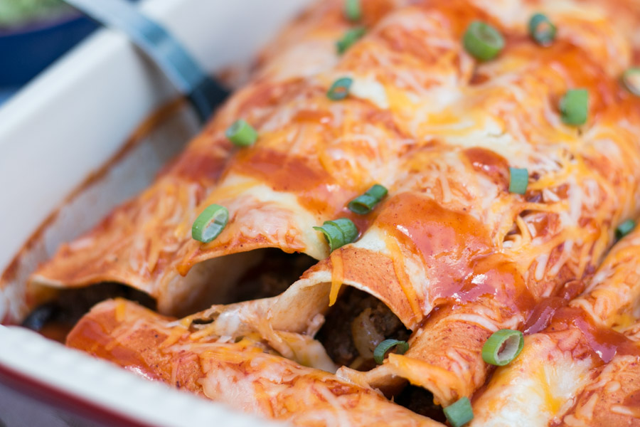 When it comes to cooking my first love is my families background of Italian cuisine but not far behind is easily making Mexican inspired meals at home. I can't tell you how delicious and really easy these Cheesy Beef & Bean Enchiladas are. A great weeknight meal for the whole family!!  #ad #claytonsorganicbeef