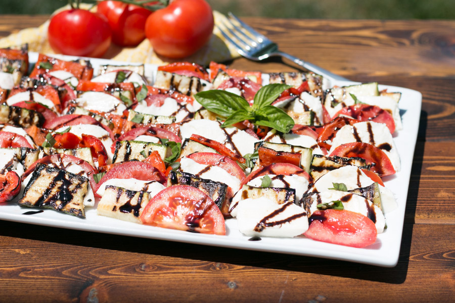 Summer is definitely here and I am thrilled to see more and more local produce available. This is my favorite season for really fresh ingredients and fresh dishes like this Grilled Vegetable Caprese Salad! A fun twist on the classic, this layered dish of grilled red bell peppers, zucchini, fresh tomatoes and  Stella® Fresh Mozzarella is what Summer cooking is all about!  #ad #StellaCheeses