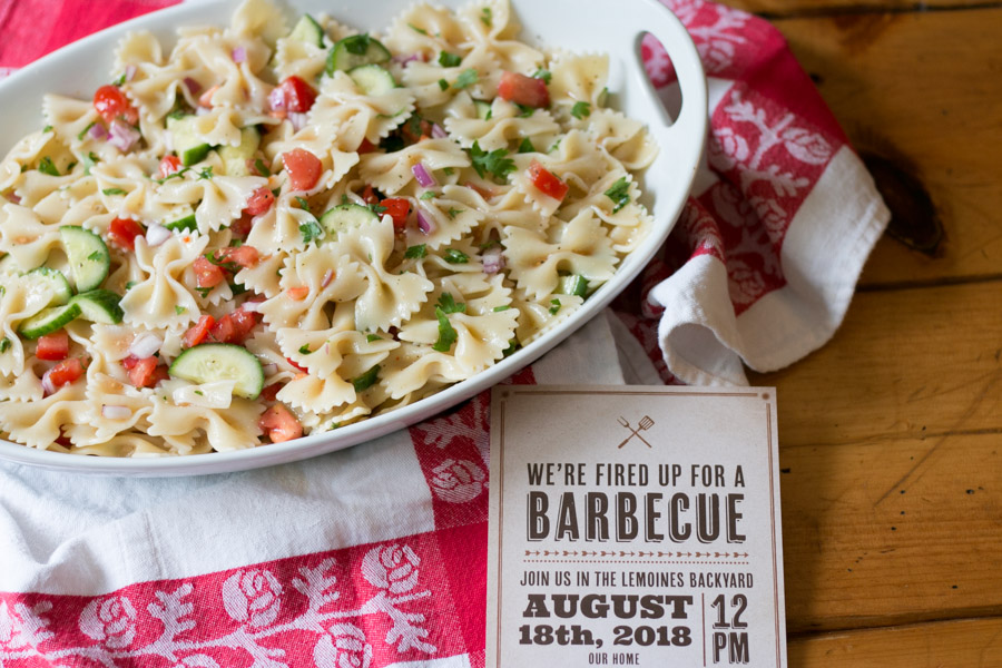 {ad} I love summer entertaining whether it be a simple backyard BBQ, a really fun clambake or hosting a milestone celebration. Today I'm sharing with you my really simple, tasty and colorful Italian Tomato Cucumber Pasta Salad PLUS The Perfect Party Invite! #basicinvite