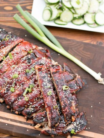 I  am so excited to share yet another incredible grilling recipe! Today I'm sharing my easy recipe for Sweet & Sour Spareribs with a Cucumber Salad. The perfect balance of flavors in a simple bbq sauce, incredibly tender spareribs and a cool refreshing cucumber salad on the side. This is a meal that Summers are made for.  #Ad #GetGrillingAmerica