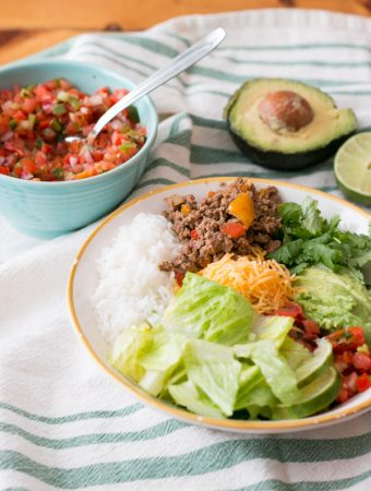 You all know that I  am all about easy meals in the Summer. This Easy Beef Burrito Bowl is so simple to throw together on even the busiest of nights and is so delicious!! Everything you'd find stuffed into a tortilla without the tortilla. This has easily become one of my go to family pleasing meals.  #claytonsorganicbeef
