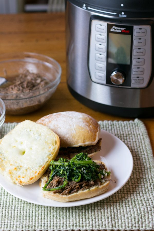 #ad Oh my!!! You guys I am so incredibly excited to share todays recipe with you for two reasons- #1 I used the NEW Power QuickPot™ Pressure Cooker and its AMAZING! #2 This recipe for Pressure Cooker Italian Beef Dip Sandwichis ridiculously easy and DELICIOUS!