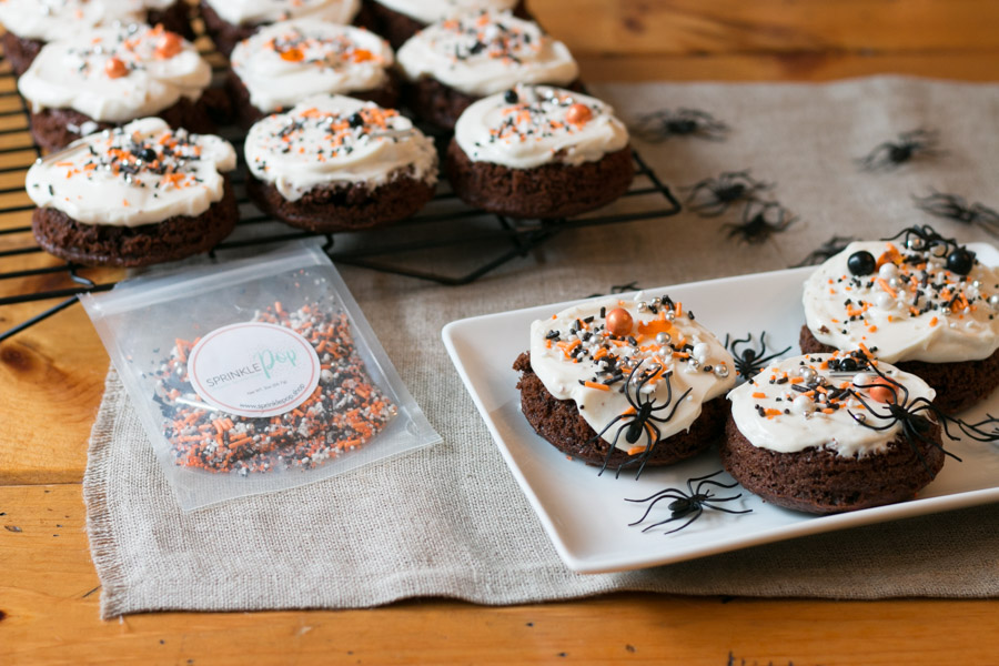 How cute are these Mini Halloween Chocolate Cakes?! Topped with cream cheese frosting and the most adorable sprinkles! #choctoberfest