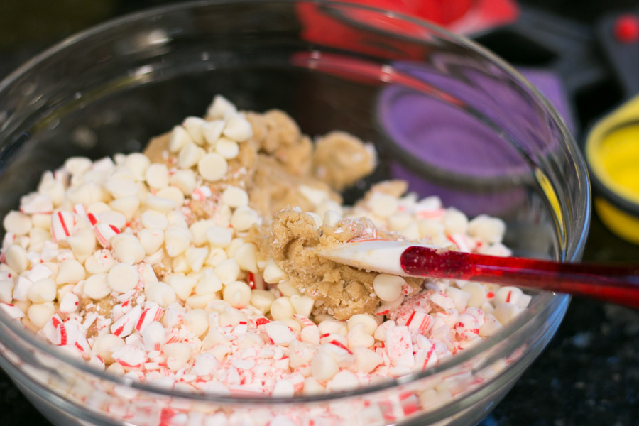 Are you all as excited as I am for holiday baking? I've always enjoyed helping in the kitchen and grew up baking alongside my mom and grandparents and now I get to pass along the tradition with my boys. These White Chocolate Candy Cane Cookies are super simple to make and the flavor and texture is spot on! A perfect addition to your cookie tray.